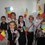 Serbare cu poezii și cântece patriotice a elevilor din Ciugud, cu prilejul Zilei Naționale a României