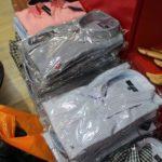 Dosar penal pentru administratorii unei firme care comercializa în Alba Iulia cămăși, tricouri și pulovere contrafăcute